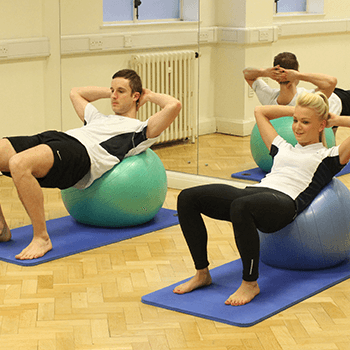 Yoga ball being used during a one-to-one pilates session
