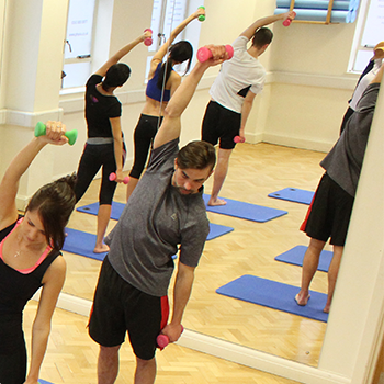 Lady stretching whilst using resistance bands
