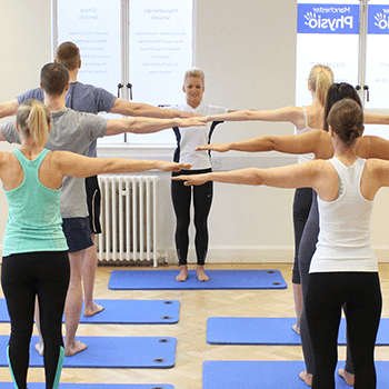 Pilates class parrallel with outstretched arms
