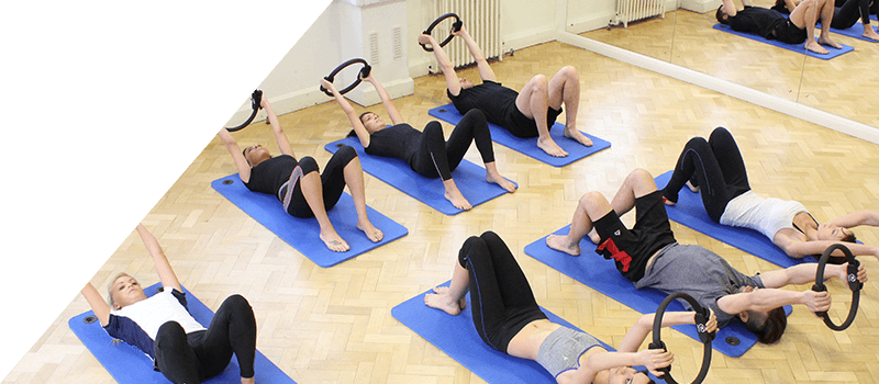 Full class uses resistance bands during Pilates session