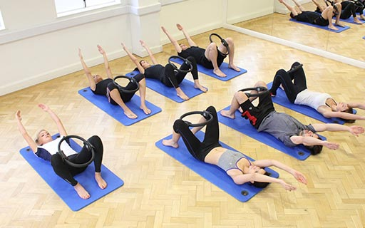 pilates group session using pilates ring