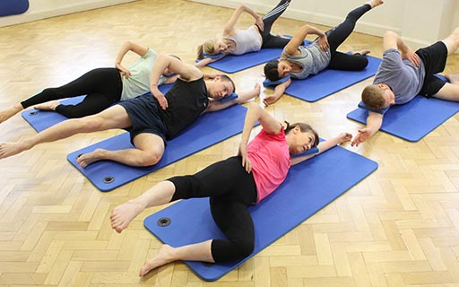 Group pilates stretch class