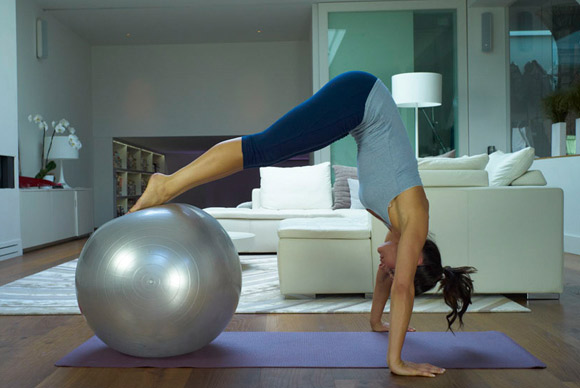 women doing pilates in a home environment.