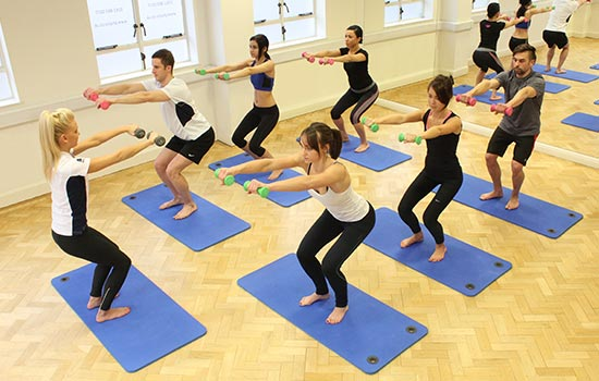 Kate conducting a group pilates class