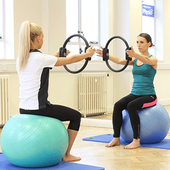 One to one session with gym balls and resistance rings