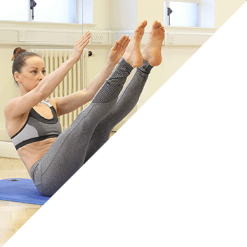 Single class member touching her toes during stretch