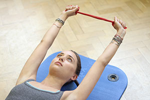 client using streching pilates tool
